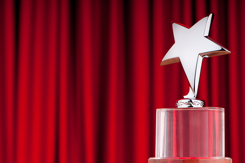 Star award against curtain background